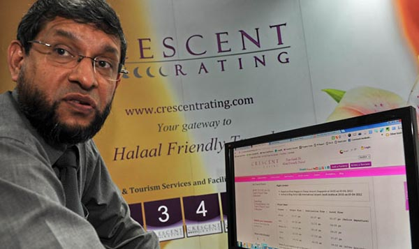 This photograph of Crescentrating chief executive Fazal Bahardeen displaying the website link to the Air Travel Prayer Time Calculator on his computer in Singapore.