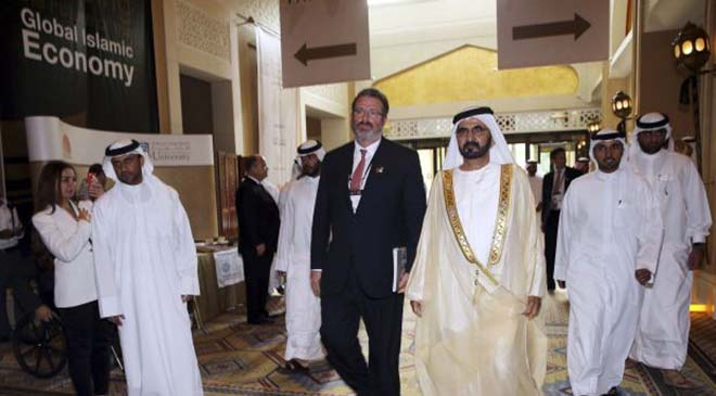 United Arab Emirates' Prime Minister and Ruler of Dubai Sheikh Mohammed bin Rashid al-Maktoum (3rd R) and Thomson Reuters President and Chief Executive Officer James Smith arrive for Global Islamic Economy Summit 2013 in Jumeirah November 25, 2013.