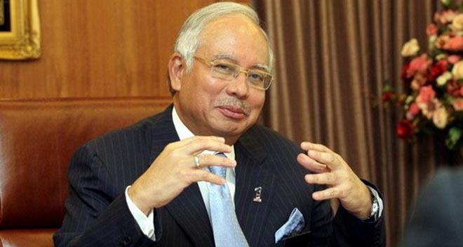 Prime Minister Datuk Seri Najib Razak replies to the local media during a Press conference