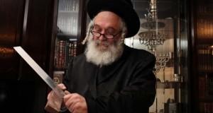 A Shochet Rabbi sharpening a kosher knife in preparation of Shechita slaughter