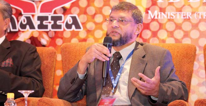 "Fazal Bahardeen, who set up Crescent Rating, an online guide to ""halal-friendly travel,"" speaks at the World Islamic Tourism Mart conference in Kuala Lumpur, Malaysia. Photo: Fazal Bahardeen"
