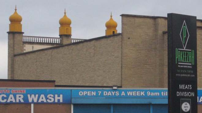 The Pakeezah meats plant site stands next to the Sikh gurdwara in Bradford