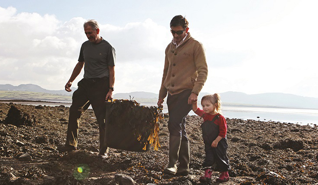Voya Products photographed for Irish Country Magazine.  Neil of Voya Products, photographed with his Dad Mick and daughter Ellie, out harvesting seaweed.