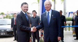 Prime Minister Datuk Seri Najib Razak greets Brunei's Crown Prince DTYM Paduka Seri Pengiran Muda Mahkota Pengiran Muda Hali Al-Muhtadee Billah as he begins his official visit of Malaysia in Putrajaya November 12, 2013. — Photo by Saw Siow Feng