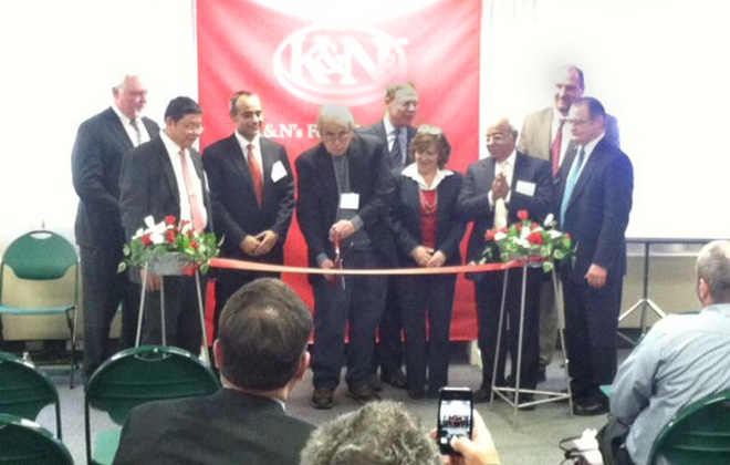 Fulton Mayor Ron Woodward cuts the ribbon at K&N's Foods inauguration Friday. Gino Geruntino