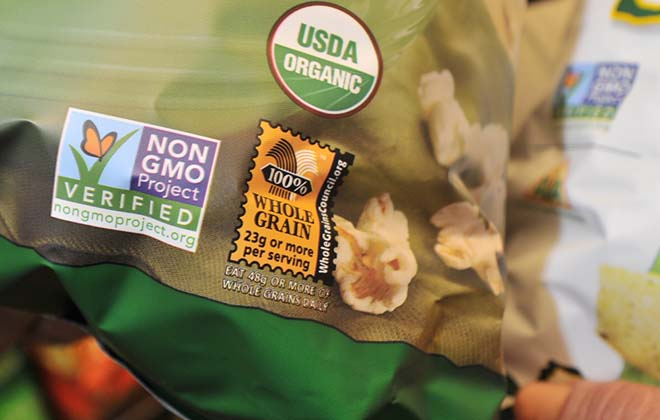 A label on a snack item at a Portland supermarket indicates it is certified organic and does not contain any genetically modified ingredients. 2013 Staff File Photo/Gordon Chibroski/Staff Photographer