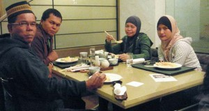 A group of Malaysian tourists enjoy Japanese food prepared in accordance with Islamic laws at Rusutsu Resort Hotel, Hokkaido, Japan